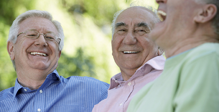 Group of older men laughing with each other
