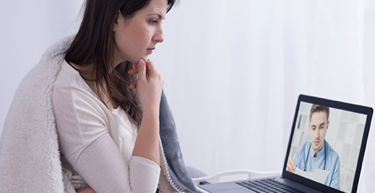 Woman talking to doctor online